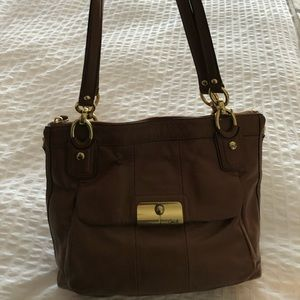 Coach chocolate leather bag with gold tone accents